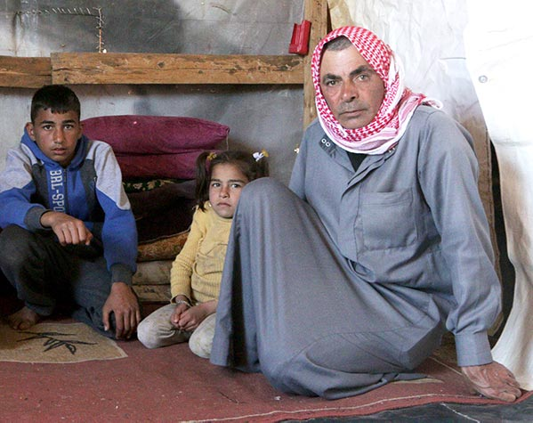 Mohamad and 2 of his children