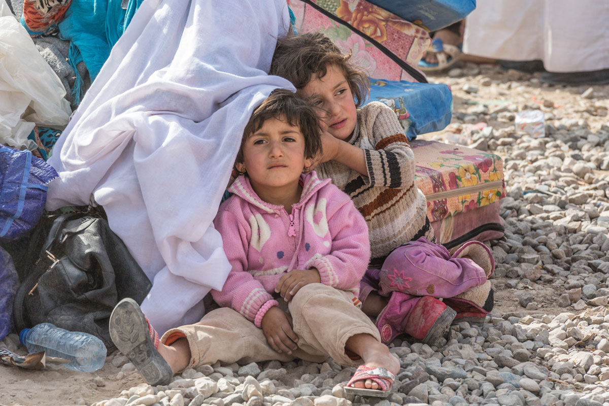Many children who fled Mosul did so in the cover of darkness, with only the clothes on their backs across harsh terrain and in freezing temperatures.