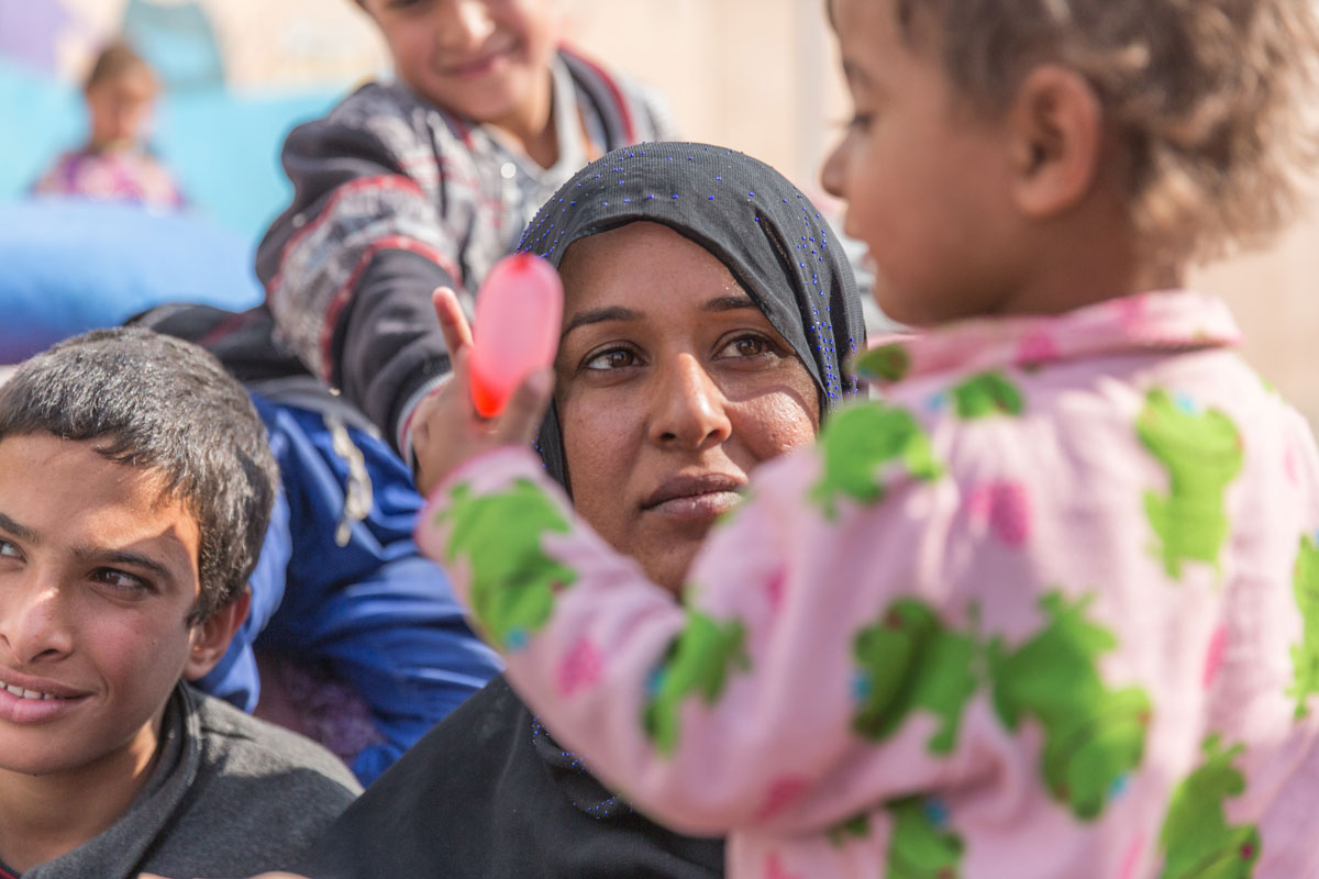 """Our lives have been very difficult, but the biggest difficulty has been for my children,"" says *Sabri, who's living with her family in Debaga Camp. ""Under ISIL, they were not allowed to play with each other and they were not allowed to go outside."""