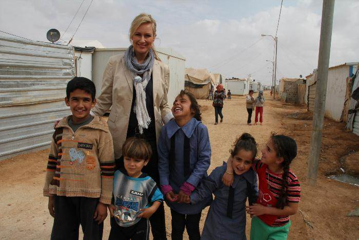 World Vision Ambassador Melissa Doyle with Syrian children in the Za'atari refugee camp in Jordan.