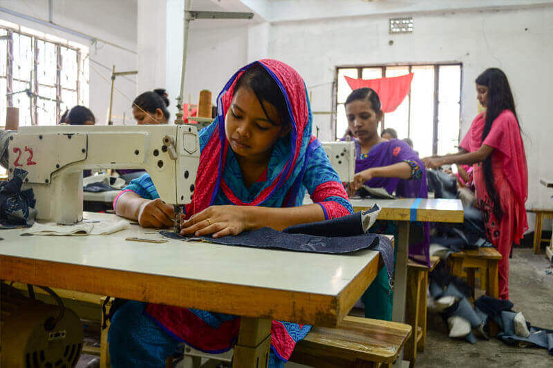 Bithi working inside a garment factory in poor conditions
