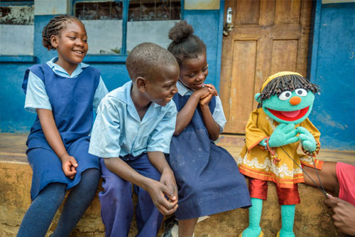 Children in Zambia learn about clean water, sanitation, water hygiene crisis, and global water with Sesame Street Muppets.