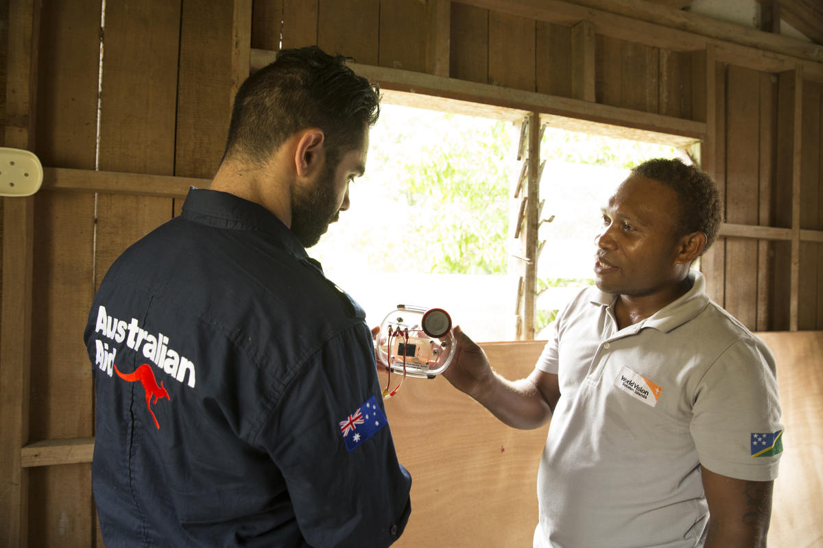 DFAT and World Vision Solomon Islands Staff inspecting flood gauges and early warning systems