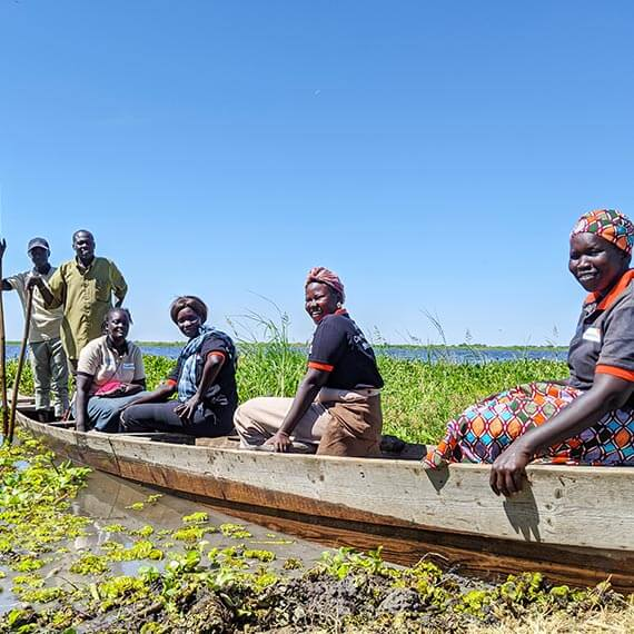 The community health workers as they take the boat to cross the Nile River.