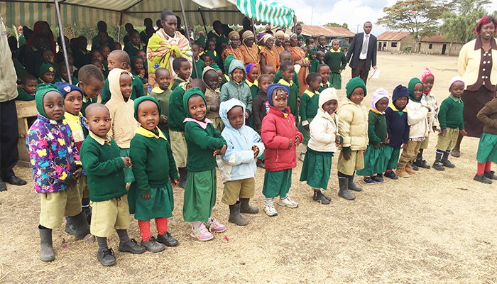 Children line up after receiving vital ID documents