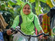 Rumana, a nutrition facilitator in southwest Bangladesh is able to ride house to house educating pregnant mothers on care for themselves and their babies, thanks to her bicycle.
