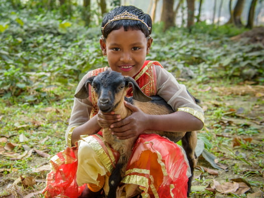 a girl with a goat