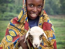 Sarah with a baby lamb that will help provide wool for clothing in north-eastern Burundi.
