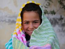 Sarah receives her own blanket for the first time at a World Vision street children centre in Afghanistan.