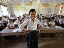 Daly leads her classmates in Cambodia in a reading exercise.