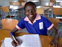 Perserverance, smiling and studying in her classroom at a primary school in Lupane District, Zimbabwe.