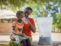 A ceramic water filter helps to protect this mother and child in Zambia from waterborne diseases.
