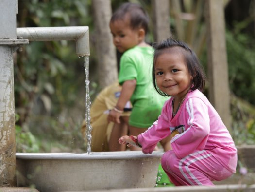 These children in Cambodia can drink and bathe in clean water all year round from this borehole fitted with a hand pump.