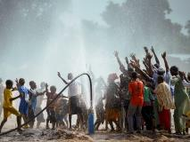 Community members in Mali sing and dance with joy when their new borehole strikes clean water.