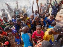 The Djenidie community of Neguela, Mali, celebrating their new borehole, World Vision's 1,500th borehole drilled in the country.