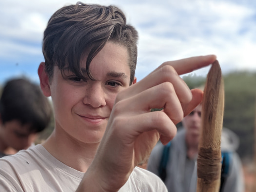Lachlan, a participant in World Vision's Young Mob Program, pictured here with a spear that the local community in Mutitjulu taught him to carve and throw.