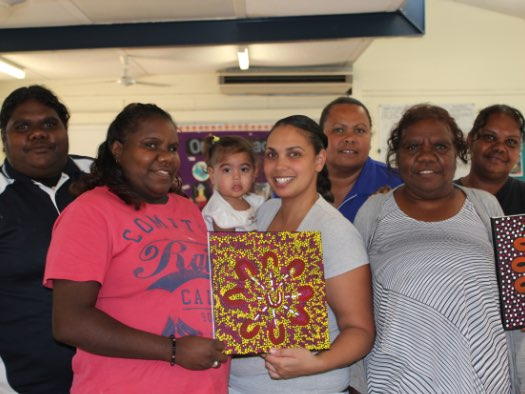 Women from Warlpiri in the Kimberley display their artworks.