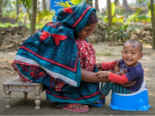 Our projects help make sure the hygiene and sanitation needs of all family members are met – even down to providing a potty for baby Durjoy in Bangladesh.