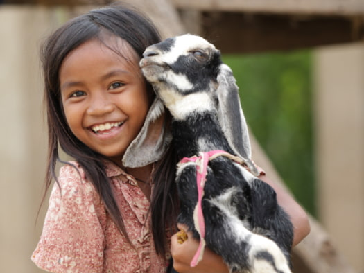 """ I am so happy to get three goats for my family, they are so lovely,"" Srey Len, from Cambodia."