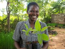 Mazaa, a participant in the Drylands Development Programme, proudly shows off growing seedlings in her community nursery in Kenya.