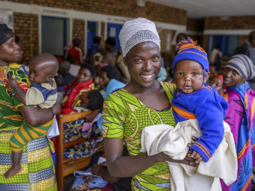 Mothers and their babies gather for maternal and child health monitoring at a clinic in Rwanda.