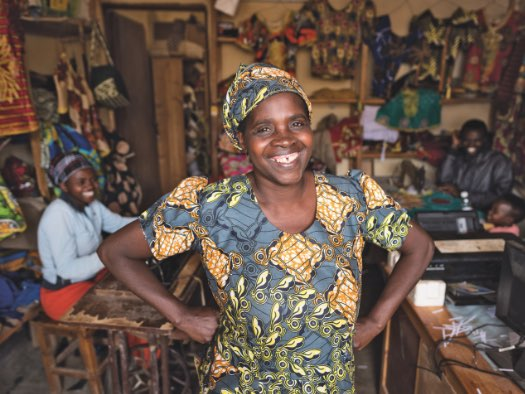 Beata is proud of her tailoring business in Rwanda, which she started with a low-cost loan.