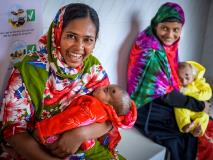 Hena holds her son at a community clinic in Bangladesh where children are immunised and mothers can participate in nutrition classes.