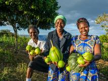 Janet, 39, and her farmers' group have transformed their once barren land into fertile, productive gardens.