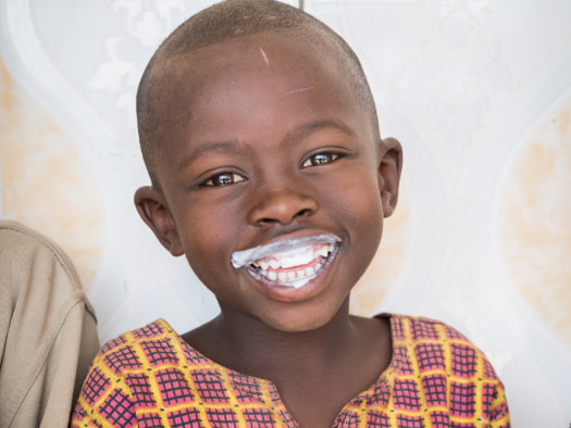 boy smiling with milk moustache