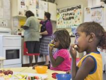 It's snack time at this playgroup in the Pilbara, as young Indigenous children enjoy some fruit.