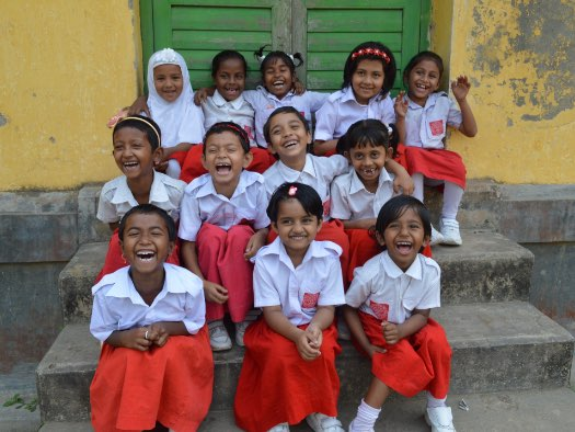 Eight-year-old Alfi , a World Vision sponsored child, enjoys time with classmates in Bangladesh.