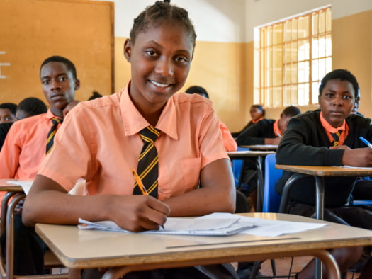 Salifyanju and her classmates enjoy learning in their spacious classroom in Zambia.