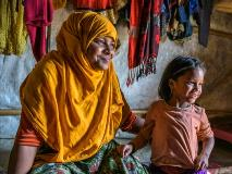 Rohingya widow Salima and her sole-surviving daughter, Jannatul take refuge and comfort in their temporary shelter in Bangladesh.