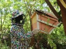In Somalia, Osman inspects the beehive he learned to set up through a vocational skills training program.