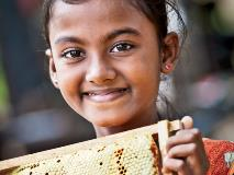 Beekeeping provides families with a new and valuable income source they can use to cover their children's education costs and pave the way towards a brighter future.