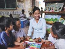 Primary school teacher Pisey plays a maths game with her students in Cambodia.