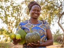 Janet and her savings group in Kenya have transformed their once barren land into fertile productive gardens.