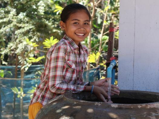 Girls using sanitised water gift