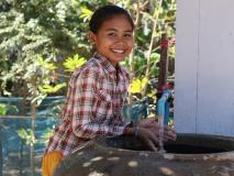 Sreyani washes her hands in the clean water of her village in Banteau Meanchey province, Cambodia.
