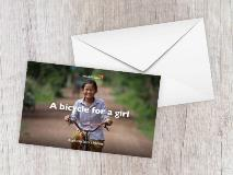 It's much easier for Daly, from Cambodia, to get to and from school now she has her own bicycle.
