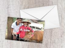 Thinh and his mum with their family's cow in Vietnam.