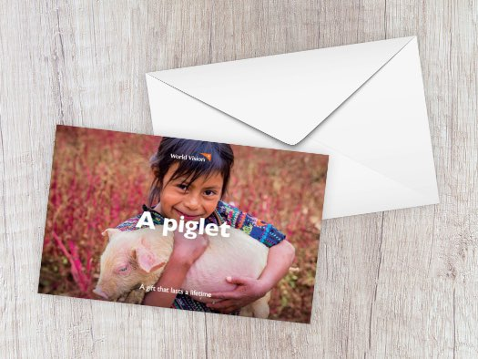 Ana, aged six, holds one of the piglets from her family's farm in Guatemala.