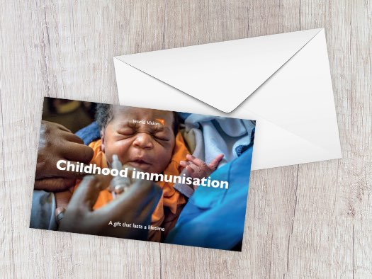 An infant receives an oral polio immunisation at a health centre in Uganda.