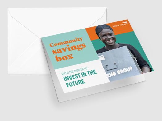 Joyce displays a community savings box where members in her group keep their weekly savings.