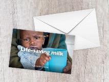 Baby Brice drinks milk as part of a program to treat malnourished children in Rwanda.