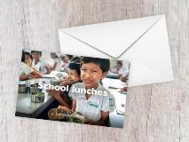 Swe, aged 11, enjoys eating with her classmates during lunch break in Myanmar.